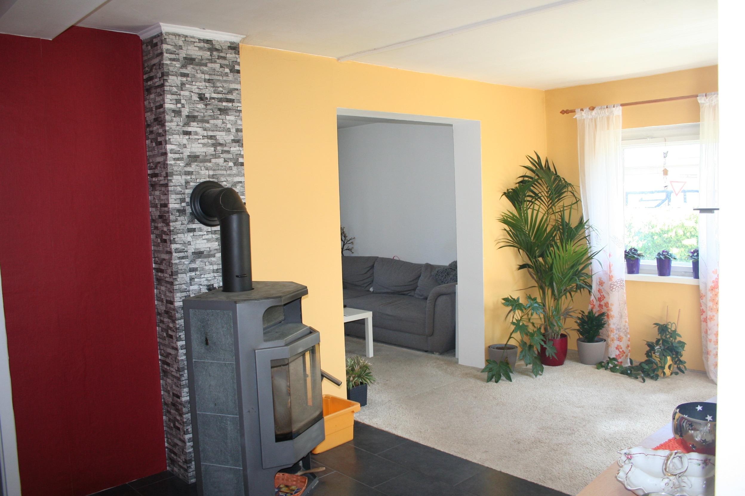 Einfamilienhaus Halle - Teil des Wohnzimmers mit Kaminofen